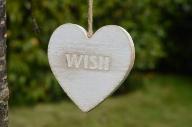 "heart-shaped ornament with 'wish"" printed on it"
