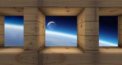 a niche view of moon through box windows